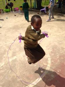 Agnes shows off her jump-rope skills at Save Africa.