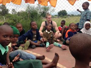 Luke, a volunteer from England, plays with the children during a break between lessons when I first visit Save Africa.