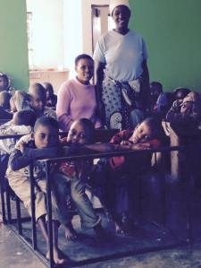 Teacher Mary and Edina with the kids during