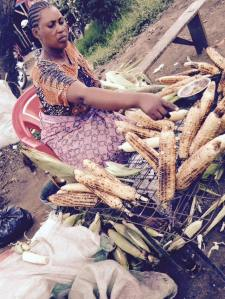 This vendor starts getting my corn, my daily lunch after leaving Save Africa, ready as soon as she sees me.