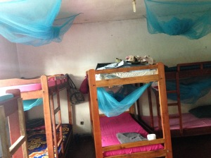 The girls bedroom, where the kids sleep three or more to a bed, some of them without sheets or pillows.